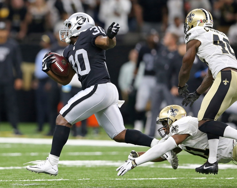 Oakland Raiders running back Jalen Richard (30) takes off on a 75-yard touchdown run against the New Orleans Saints during the fourth quarter at the Mercedes-Benz Superdome. The Raiders won 35-34.