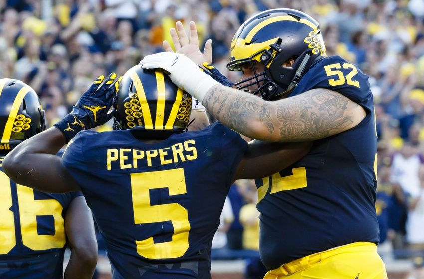 Sep 17, 2016; Ann Arbor, MI, USA; Michigan Wolverines linebacker Jabrill Peppers (5) receives congratulations from offensive lineman Mason Cole (52) after he scores a touchdown in the second half against the Colorado Buffaloes at Michigan Stadium. Michigan won 45-28. Mandatory Credit: Rick Osentoski-USA TODAY Sports