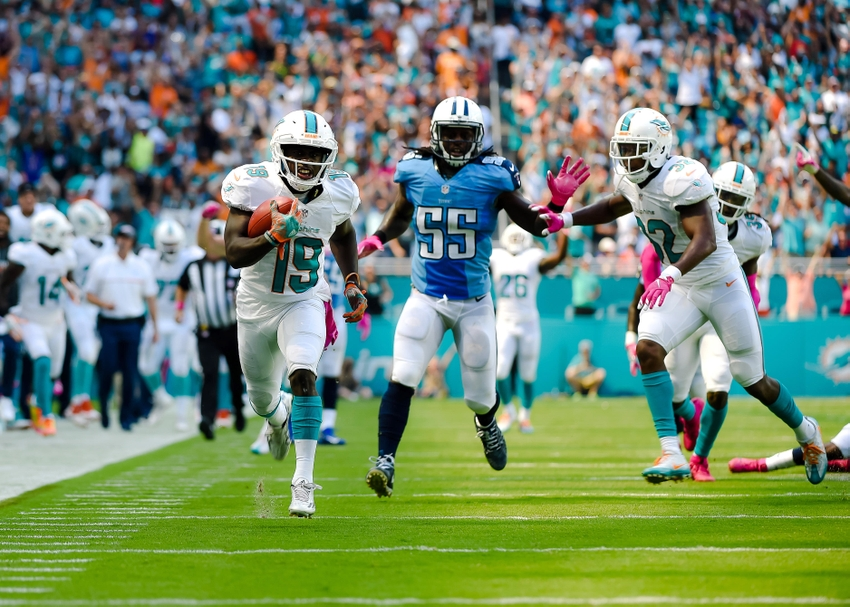 Oct 9, 2016; Miami Gardens, FL, USA; Miami Dolphins wide receiver Jakeem Grant (19) runs in a touchdown past Tennessee Titans inside linebacker Sean Spence (55) during the first half against at Hard Rock Stadium. Mandatory Credit: Steve Mitchell-USA TODAY Sports