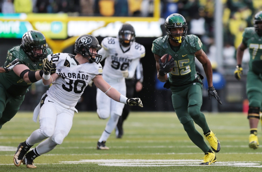 Colorado Buffaloes linebacker Ryan Severson (30) chases Oregon Ducks tight end Pharaoh Brown (85) at Autzen Stadium.