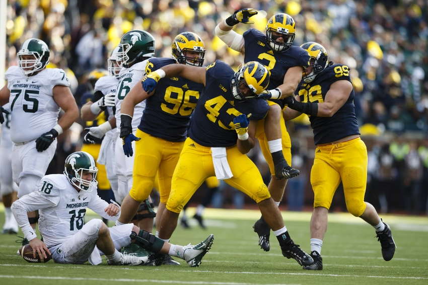 Michigan Wolverines defensive end Chris Wormley (43) celebrates his sack of Michigan State Spartans quarterback Connor Cook (18) in the first half at Michigan Stadium.