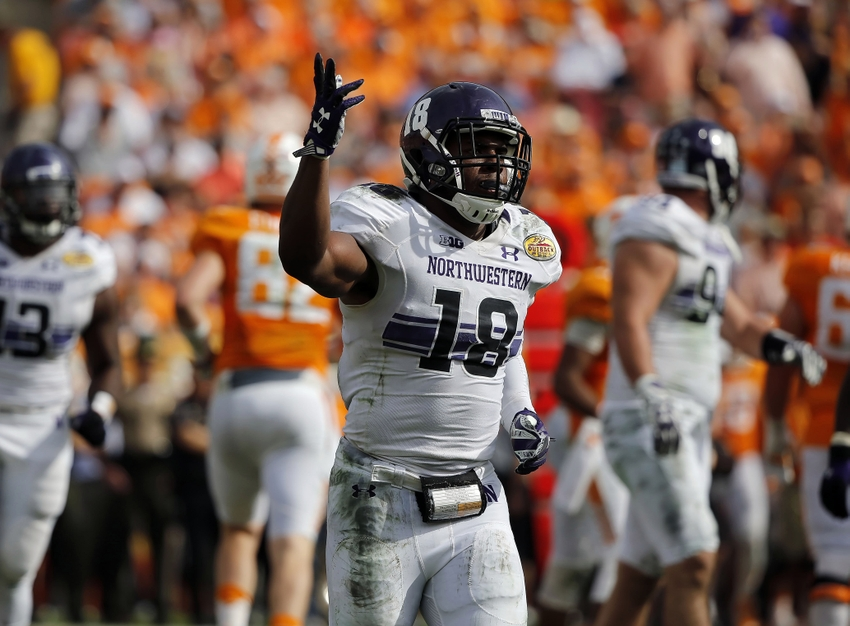 Northwestern Wildcats linebacker Anthony Walker (18) celebrates as he made a sack against the Tennessee Volunteers during the first half in the 2016 Outback Bowl at Raymond James Stadium.