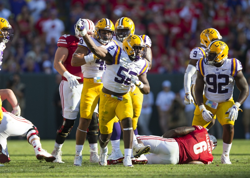 LSU Tigers linebacker Kendell Beckwith (52) celebrates following a play during the third quarter against the Wisconsin Badgers at Lambeau Field.