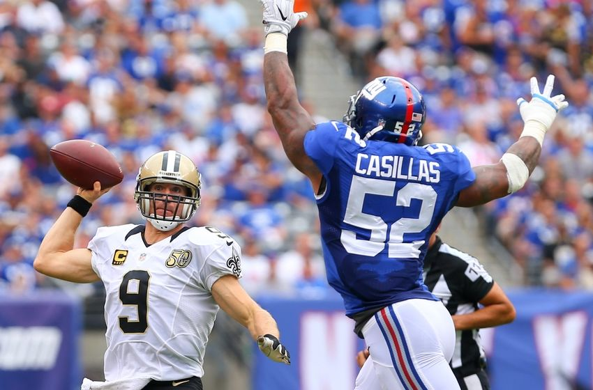 Sep 18, 2016; East Rutherford, NJ, USA; New Orleans Saints quarterback Drew Brees (9) runs out of the pocket to avoid New York Giants outside linebacker Jonathan Casillas (52) during the first half at MetLife Stadium. Mandatory Credit: Ed Mulholland-USA TODAY Sports