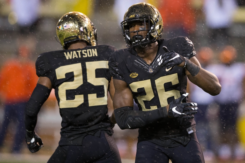 Wake Forest Demon Deacons linebacker Thomas Brown (26) celebrates with defensive back Brad Watson (25) after a stop in the first quarter against the Syracuse Orange at BB&T Field.