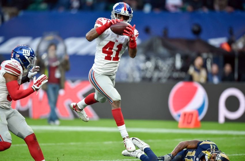 Oct 23, 2016; London, ENG; Cornerback Dominique Rodgers-Cromartie (41) of the New York Giants intercepts a 4 yard pass from quarterback Case Keenum (17) of the Los Angeles Rams during the fourth quarter of the game between the Los Angeles Rams and the New York Giants at Twickenham Stadium. Mandatory Credit: Steve Flynn-USA TODAY Sports