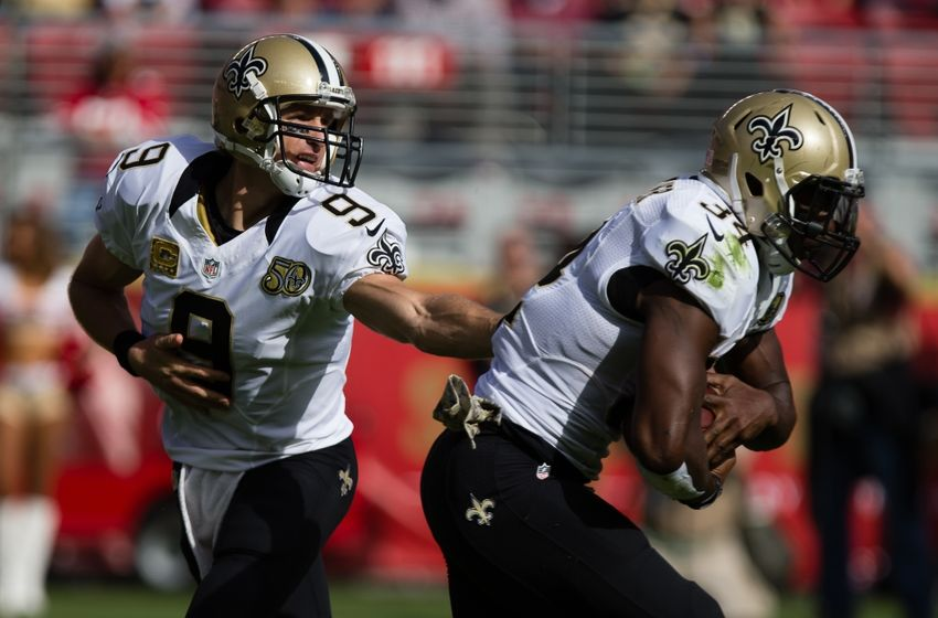 Nov 6, 2016; Santa Clara, CA, USA; New Orleans Saints quarterback Drew Brees (9) hands off to running back Tim Hightower (34) against the San Francisco 49ers during the first quarter at Levi