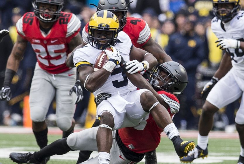 Nov 26, 2016; Columbus, OH, USA; Michigan Wolverines linebacker Jabrill Peppers (5) is tackled by Ohio State Buckeyes wide receiver Terry McLaurin (83) after an interception at Ohio Stadium. Ohio State won the game 30-27 in double overtime. Mandatory Credit: Greg Bartram-USA TODAY Sports