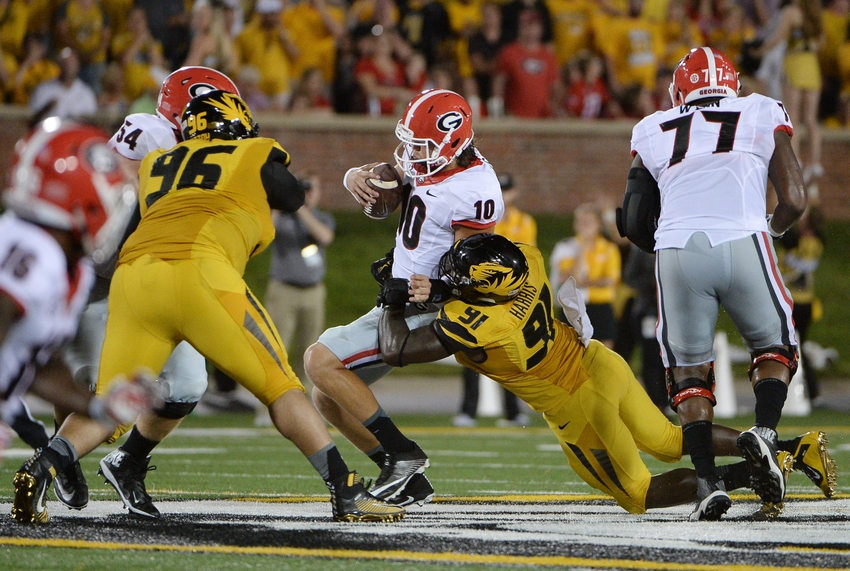 Sep 17, 2016; Columbia, MO, USA; Georgia Bulldogs quarterback Jacob Eason (10) is sacked by Missouri Tigers defensive end Charles Harris (91) in the first half at Faurot Field. Mandatory Credit: John Rieger-USA TODAY Sports