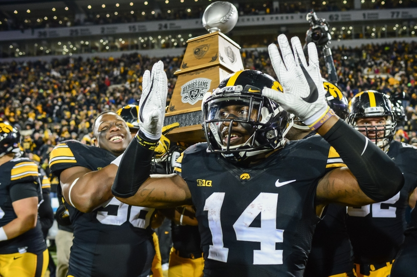 Nov 25, 2016; Iowa City, IA, USA; Iowa Hawkeyes defensive back Desmond King (14) celebrates after the game against the Nebraska Cornhuskers at Kinnick Stadium. Iowa won 40-10 and secured the Heroes Game trophy. Mandatory Credit: Jeffrey Becker-USA TODAY Sports