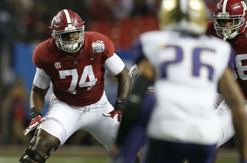 Dec 31, 2016; Atlanta, GA, USA; Alabama Crimson Tide offensive lineman Cam Robinson (74) works at the line of scrimmage during the third quarter in the 2016 CFP Semifinal Washington Huskies at the Georgia Dome. Mandatory Credit: Jason Getz-USA TODAY Sports