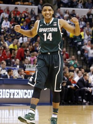 Mar 15, 2014; Indianapolis, IN, USA; Michigan State Spartans guard Gary Harris (14) reacts to a score by the Spartans in a game against the Wisconsin Badgers in the semifinals of the Big Ten college basketball tournament at Bankers Life Fieldhouse. Mandatory Credit: Brian Spurlock-USA TODAY Sports
