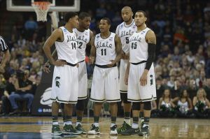 Mar 20, 2014; Spokane, WA, USA; Michigan State Spartans guard Gary Harris (14), guard/forward Branden Dawson (22), guard Keith Appling (11), forward Adreian Payne (5), and guard Denzel Valentine (45) look on in the second half of a men