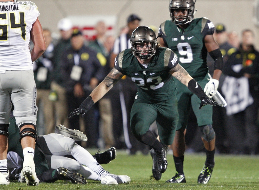 Sep 12, 2015; East Lansing, MI, USA; Michigan State Spartans linebacker Chris Frey (23) celebrates after making a play during the fourth quarter against the Oregon Ducks at Spartan Stadium. The Spartans beat the Ducks 31-28. Mandatory Credit: Raj Mehta-USA TODAY Sports