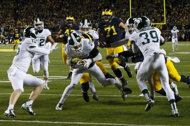 8866786-ncaa-football-michigan-state-michigan-1-768x511