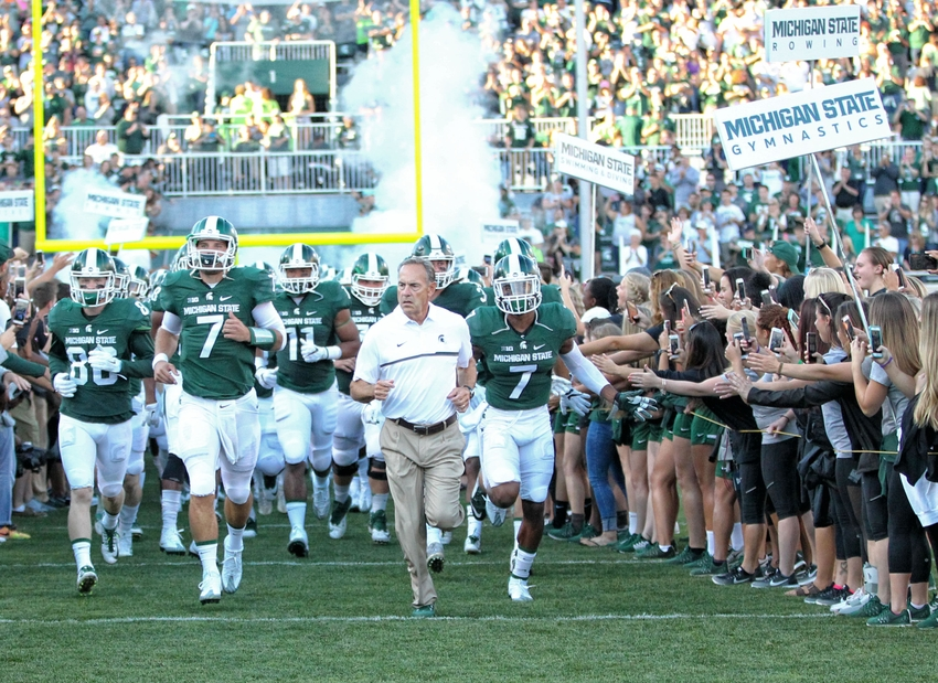 Sep 2, 2016; East Lansing, MI, USA; Michigan State Spartans head coach Mark Dantonio (C) leads his team onto the field prior to their game against the Furman Paladins at Spartan Stadium. Mandatory Credit: Mike Carter-USA TODAY Sports