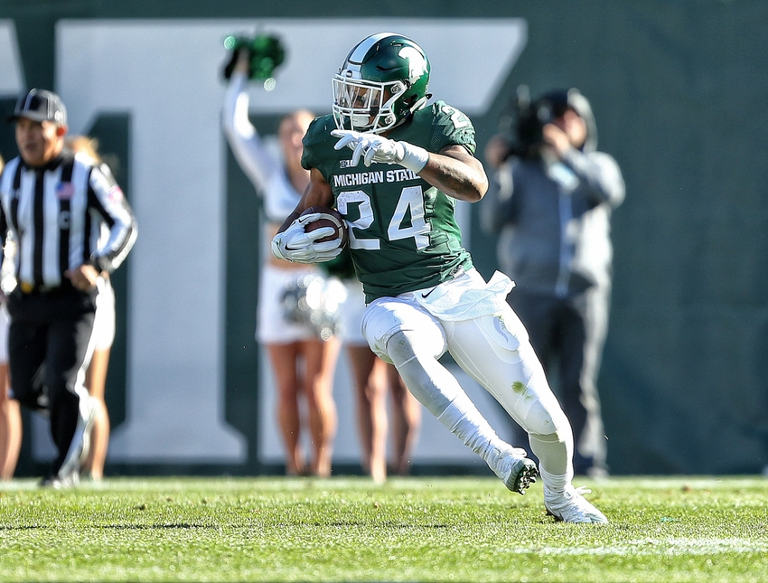Oct 8, 2016; East Lansing, MI, USA; Michigan State Spartans running back Gerald Holmes (24) runs the ball during the first half of a game against the Brigham Young Cougars at Spartan Stadium. Mandatory Credit: Mike Carter-USA TODAY Sports
