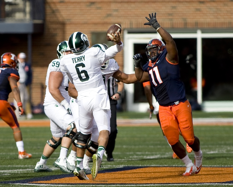 Nov 5, 2016; Champaign, IL, USA; Illinois Fighting Illini defensive lineman Chunky Clements (11) pressures Michigan State Spartans quarterback Damion Terry (6) on a throw during the fourth quarter at Memorial Stadium. Illinois beat Michigan State 31-27. Mandatory Credit: Mike Granse-USA TODAY Sports