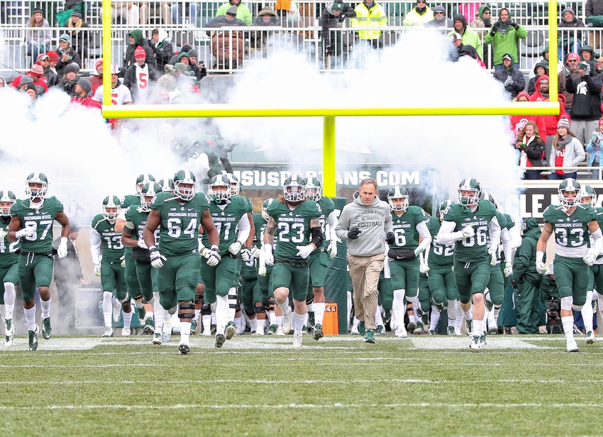 Nov 19, 2016; East Lansing, MI, USA; Michigan State Spartans head coach Mark Dantonio leads his team onto the field prior to the game against the Ohio State Buckeyes at Spartan Stadium. Mandatory Credit: Mike Carter-USA TODAY Sports