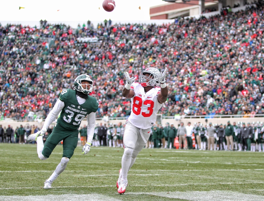 Nov 19, 2016; East Lansing, MI, USA; Ohio State Buckeyes wide receiver Terry McLaurin (83) attempts to catch a pass in front of Michigan State Spartans wide receiver Justin Layne (39) during the first half of a game at Spartan Stadium. Mandatory Credit: Mike Carter-USA TODAY Sports