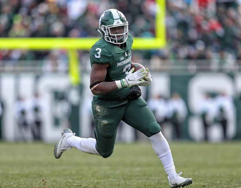 Nov 19, 2016; East Lansing, MI, USA; Michigan State Spartans running back LJ Scott (3) runs the ball during the second half of a game against the Ohio State Buckeyes at Spartan Stadium. Mandatory Credit: Mike Carter-USA TODAY Sports