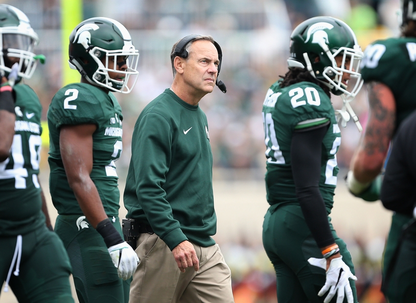 Oct 29, 2016; East Lansing, MI, USA; Michigan State Spartans head coach Mark Dantonio stands with his players between plays during the second half of a game at Spartan Stadium. Mandatory Credit: Mike Carter-USA TODAY Sports