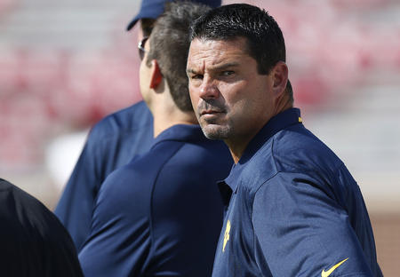 West Virginia Associate head coach/special teams coordinator Joe DeForest is pictured on the sidelines before the start of an NCAA college football game against Oklahoma in Norman, Okla., Saturday, Sept. 7, 2013. (AP Photo/Sue Ogrocki)