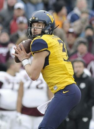 Dec 29, 2014; Memphis, TN, USA; West Virginia Mountaineers quarterback Skyler Howard (3) during the game against the Texas A&M Aggies in the 2014 Liberty Bowl at Liberty Bowl Memorial Stadium. Mandatory Credit: Justin Ford-USA TODAY Sports