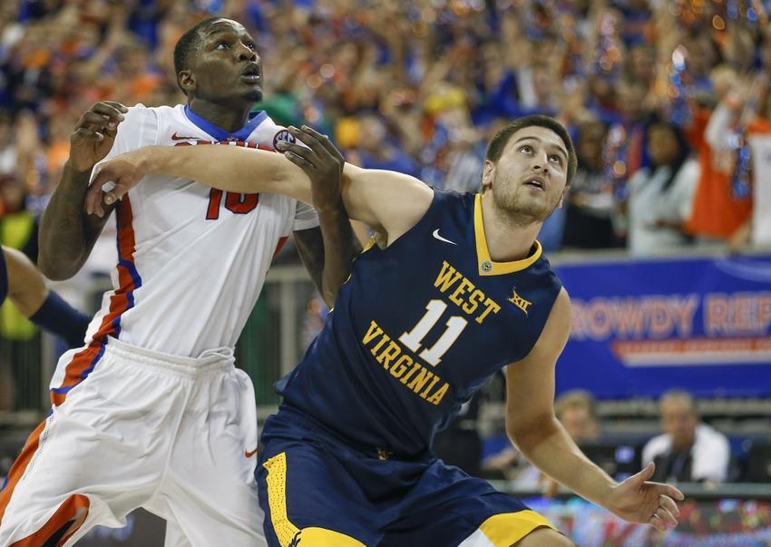 Dorian-finney-smith-nathan-adrian-ncaa-basketball-west-virginia-florida