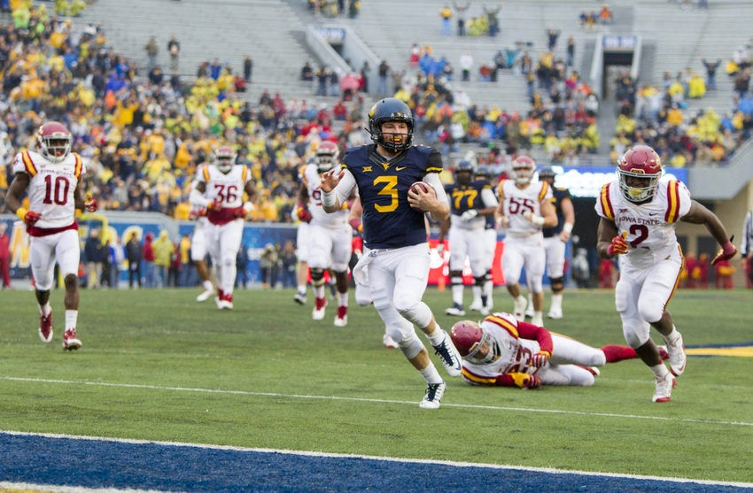 Nov 28, 2015; Morgantown, WV, USA; West Virginia Mountaineers quarterback Skyler Howard (3) runs for a touchdown during the third quarter against the Iowa State Cyclones at Milan Puskar Stadium. Mandatory Credit: Ben Queen-USA TODAY Sports