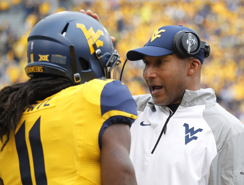 Oct 4, 2014; Morgantown, WV, USA; West Virginia Mountaineers wide receiver Kevin White (11) listens to receivers coach Lonnie Galloway (R) on the sidelines against the Kansas Jayhawks during the first quarter at Milan Puskar Stadium. West Virginia won 33-14. Mandatory Credit: Charles LeClaire-USA TODAY Sports