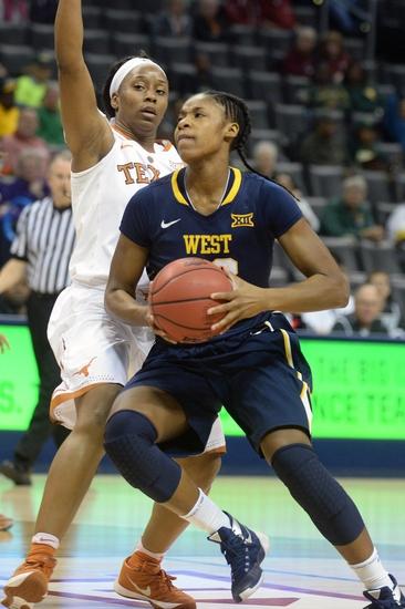 Empress-davenport-bria-holmes-ncaa-womens-basketball-big-12-conference-tournament-texas-vs-west-virginia