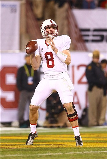 Dec 7, 2013; Tempe, AZ, USA; Stanford Cardinal quarterback Kevin Hogan (8) throws a pass in the second half against the Arizona State Sun Devils at Sun Devil Stadium. Stanford defeated Arizona State 38-14. Mandatory Credit: Mark J. Rebilas-USA TODAY Sports