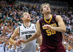 Jan 11, 2014; East Lansing, MI, USA; Michigan State Spartans forward Matt Costello (10) and Minnesota Golden Gophers center Elliott Eliason (55) fight for position during the 1st half of a game at Jack Breslin Student Events Center. Mandatory Credit: Mike Carter-USA TODAY Sports