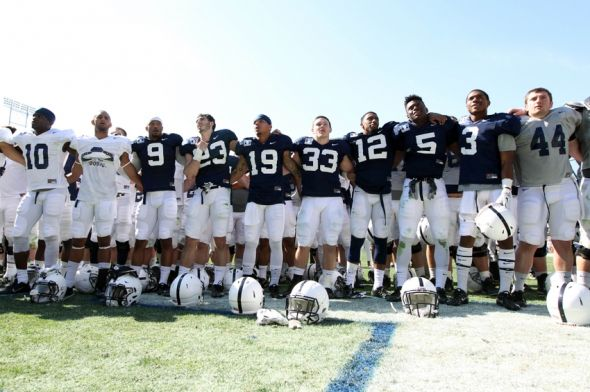 Apr 12, 2014; State College, PA, USA; Penn State Nittany Lions players sing the alma mater following the completion of the Blue White spring game at Beaver Stadium. The Blue team defeated the White team 37-0. Mandatory Credit: Matthew O'Haren- USA TODAY Sports