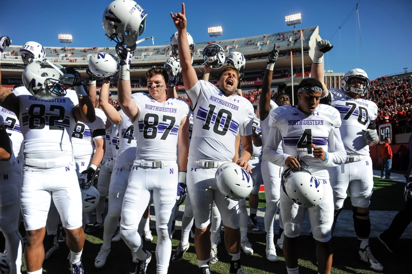 Oct 24, 2015; Lincoln, NE, USA; Northwestern Wildcats quarterback Zack Oliver (10) leads the cheers after a win against the Nebraska Cornhuskers at Memorial Stadium. Northwestern defeated Nebraska 30-28. Mandatory Credit: Steven Branscombe-USA TODAY Sports