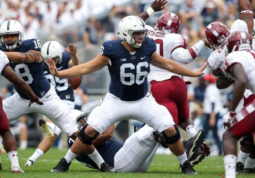 Sep 17, 2016; University Park, PA, USA; Penn State Nittany Lions offensive linesmen Connor McGovern (66) blocks during the third quarter against the Temple Owls at Beaver Stadium. Penn State defeated Temple 34-27. Mandatory Credit: Matthew O