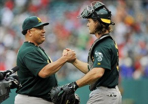 July 21, 2013; Anaheim, CA, USA; Oakland Athletics starting pitcher Bartolo Colon (40) celebrates his 6-0 complete game victory with catcher John Jaso (5) against the Los Angeles Angels at Angel Stadium of Anaheim. Mandatory Credit: Gary A. Vasquez-USA TODAY Sports
