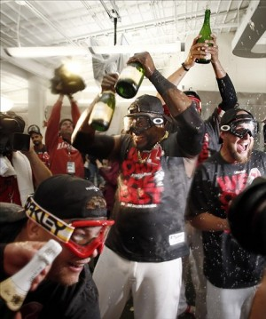 Sep 20, 2013; Boston, MA, USA; Boston Red Sox player David Ortiz (34) leads the celebration after they won the AL East with a win over the Toronto Blue Jays at Fenway Park. Mandatory Credit: Winslow Townson-USA TODAY Sports