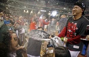 Sep 20, 2013; Boston, MA, USA; Boston Red Sox relief pitcher Junichi Tazawa (right) and Mike Napoli (left) spray champagne after they clinched the AL East with a win over the Toronto Blue Jays at Fenway Park. Mandatory Credit: Winslow Townson-USA TODAY Sports