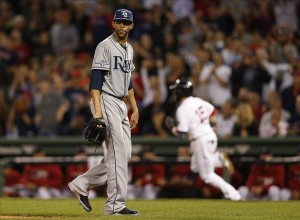 Oct 5, 2013; Boston, MA, USA; Tampa Bay Rays pitcher David Price (14) reacts to giving up an RBI double to Boston Red Sox second baseman Dustin Pedroia (15) during the fifth inning in game two of the American League divisional series playoff baseball game at Fenway Park. Mandatory Credit: Greg M. Cooper-USA TODAY Sports
