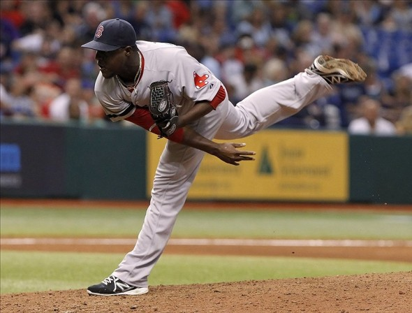 Sep 12, 2013; St. Petersburg, FL, USA; Boston Red Sox relief pitcher Rubby De La Rosa (62) throws a pitch during the eighth inning against the Tampa Bay Rays at Tropicana Field. Tampa Bay Rays defeated the Boston Red Sox 4-3. Mandatory Credit: Kim Klement-USA TODAY Sports