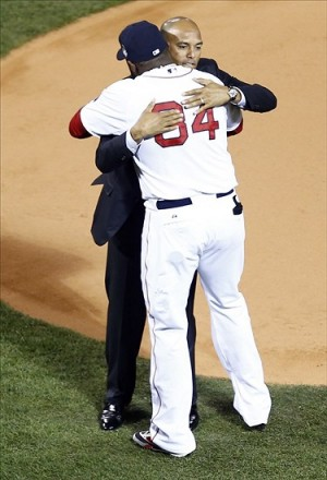 Oct 24, 2013; Boston, MA, USA; New York Yankees former pitcher Mariano Rivera hugs Boston Red Sox designated hitter David Ortiz (34) prior to game two of the MLB baseball World Series between the Boston Red Sox and the St. Louis Cardinals at Fenway Park. . Mandatory Credit: Mark L. Baer-USA TODAY Sports