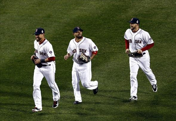 Oct 23, 2013; Boston, MA, USA; Boston Red Sox center fielder Jacoby Ellsbury (left) right fielder Shane Victorino (center), and right fielder Daniel Nava (right) celebrate after defeating the St. Louis Cardinals in game one of the MLB baseball World Series at Fenway Park. Boston won 8-1. Mandatory Credit: Mark L. Baer-USA TODAY Sports