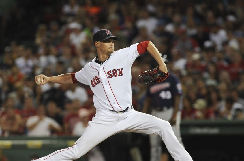 Jul 23, 2016; Boston, MA, USA; Boston Red Sox relief pitcher Clay Buchholz (11) pitches during the sixth inning against the Minnesota Twins at Fenway Park. Mandatory Credit: Bob DeChiara-USA TODAY Sports