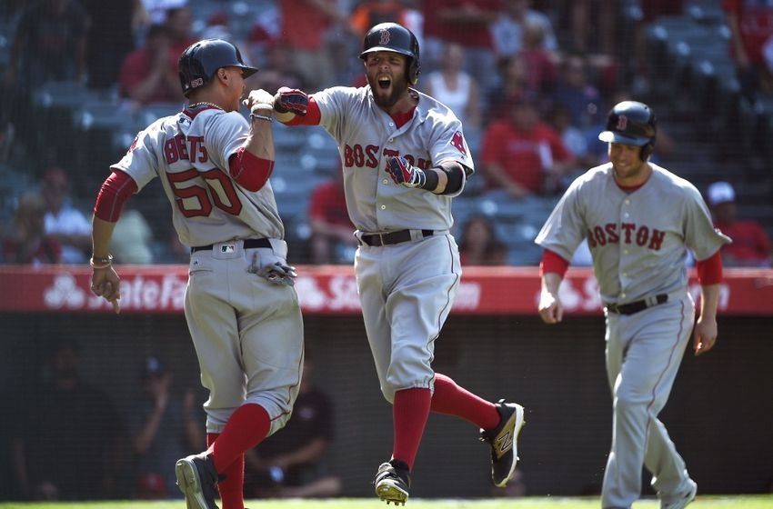 Jul 31, 2016; Anaheim, CA, USA; Boston Red Sox second baseman Dustin Pedroia (center) celebrates with right fielder Mookie Betts (left) after hitting a three-run home run against the Los Angeles Angels during the ninth inning at Angel Stadium of Anaheim. Mandatory Credit: Kelvin Kuo-USA TODAY Sports