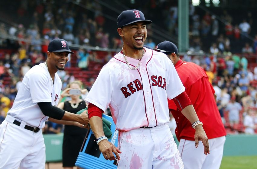 Aug 14, 2016; Boston, MA, USA; Boston Red Sox right fielder Mookie Betts (50) smiles after he was doused with Powerade by shortstop Xander Bogaerts (2) after the Boston Red Sox 16-2 win over the Arizona Diamondbacks at Fenway Park. Betts had three home runs in the win. Mandatory Credit: Winslow Townson-USA TODAY Sports