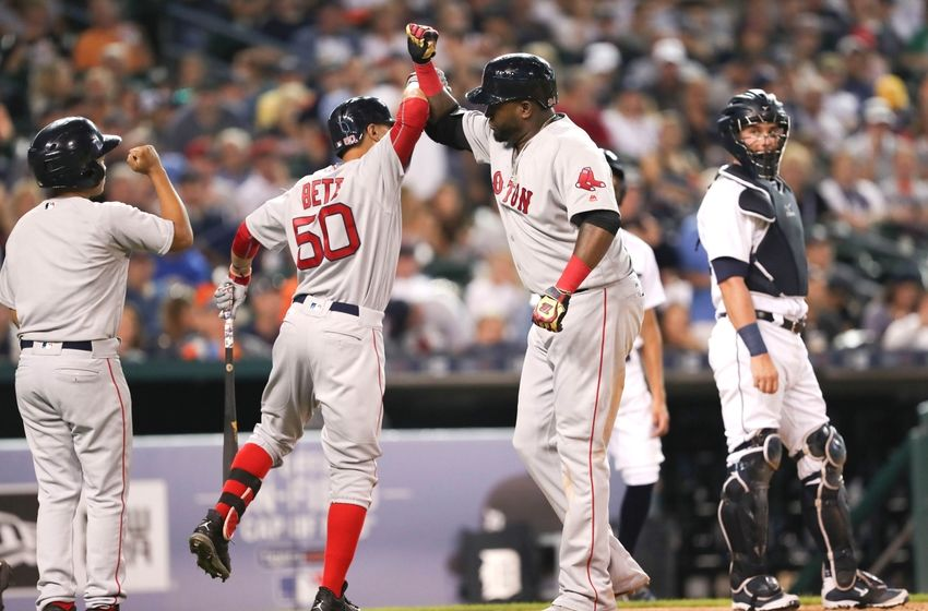 Aug 20, 2016; Detroit, MI, USA; Boston Red Sox designated hitter David Ortiz (34) celebrates with right fielder Mookie Betts (50) during the fifth inning against the Detroit Tigers at Comerica Park. Mandatory Credit: Raj Mehta-USA TODAY Sports