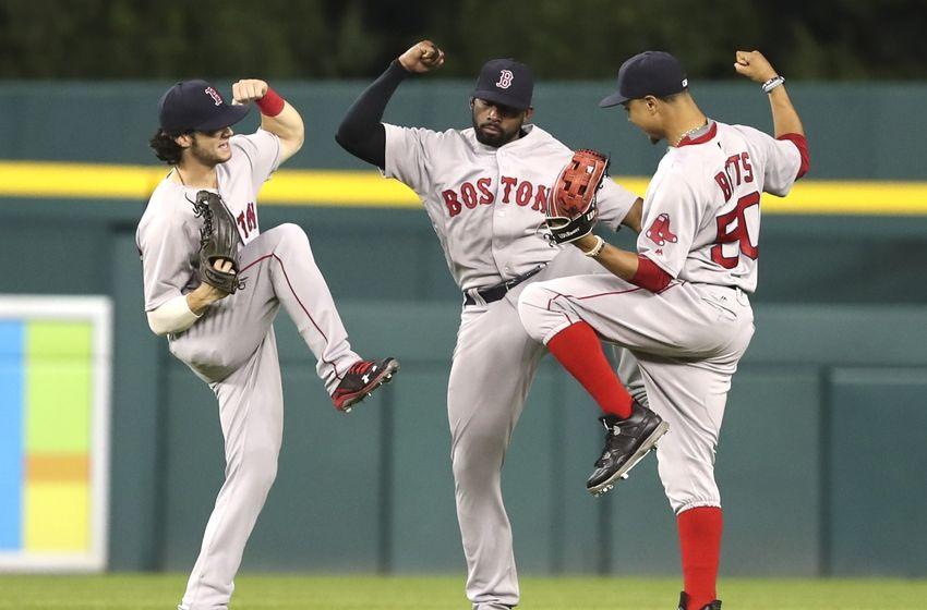 Aug 20, 2016; Detroit, MI, USA; Boston Red Sox left fielder Andrew Benintendi (left) center fielder Jackie Bradley Jr. (center) and right fielder Mookie Betts (right) celebrate after the game against the Detroit Tigers at Comerica Park. Red Sox win 3-2. Mandatory Credit: Raj Mehta-USA TODAY Sports