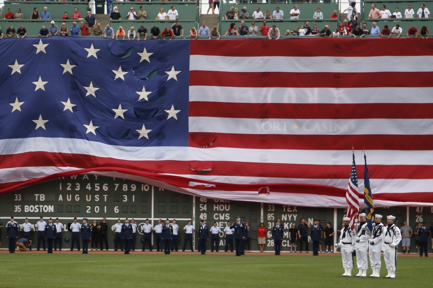 Aug 31, 2016; Boston, MA, USA; A giant American flag begins to cover the green monster before a game between the Tampa Bay Rays and the Boston Red Sox at Fenway Park. Mandatory Credit: Greg M. Cooper-USA TODAY Sports